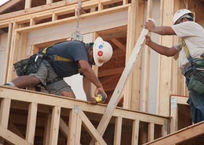 Construction carpenters measuring up a job