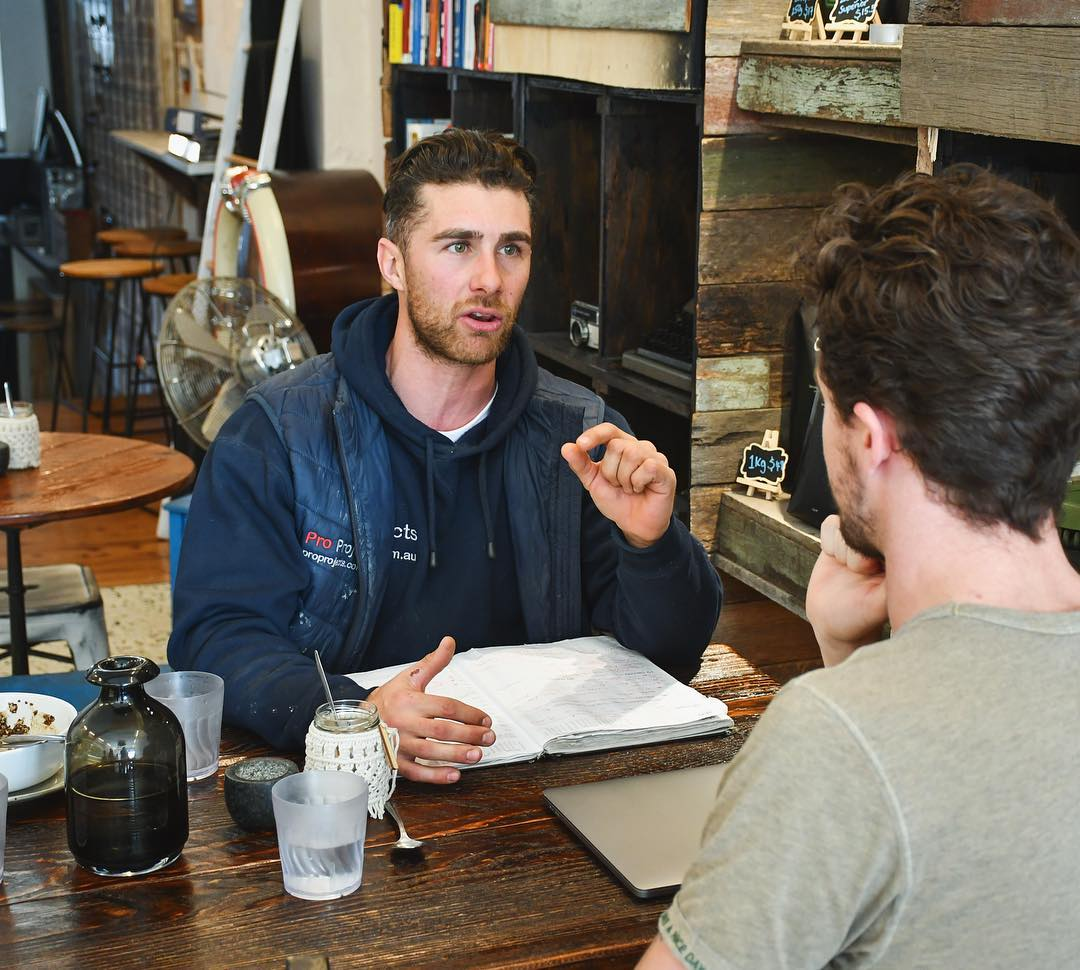 2 men planning a bathroom renovation in a Newtown cafe