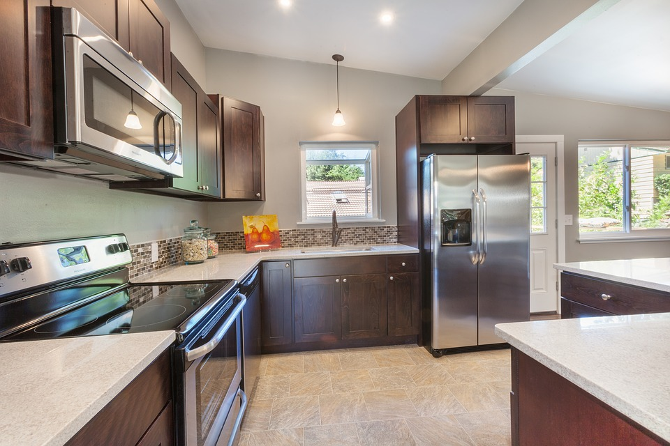 A Alexandria kitchen renovations with custom dark wood cabinetry