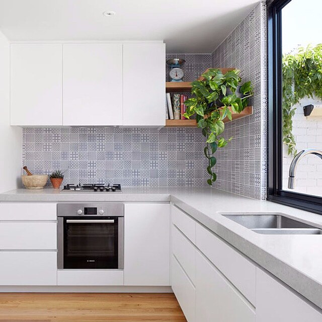 A Bankstown kitchen renovation with stone bench top and stainless steel appliances