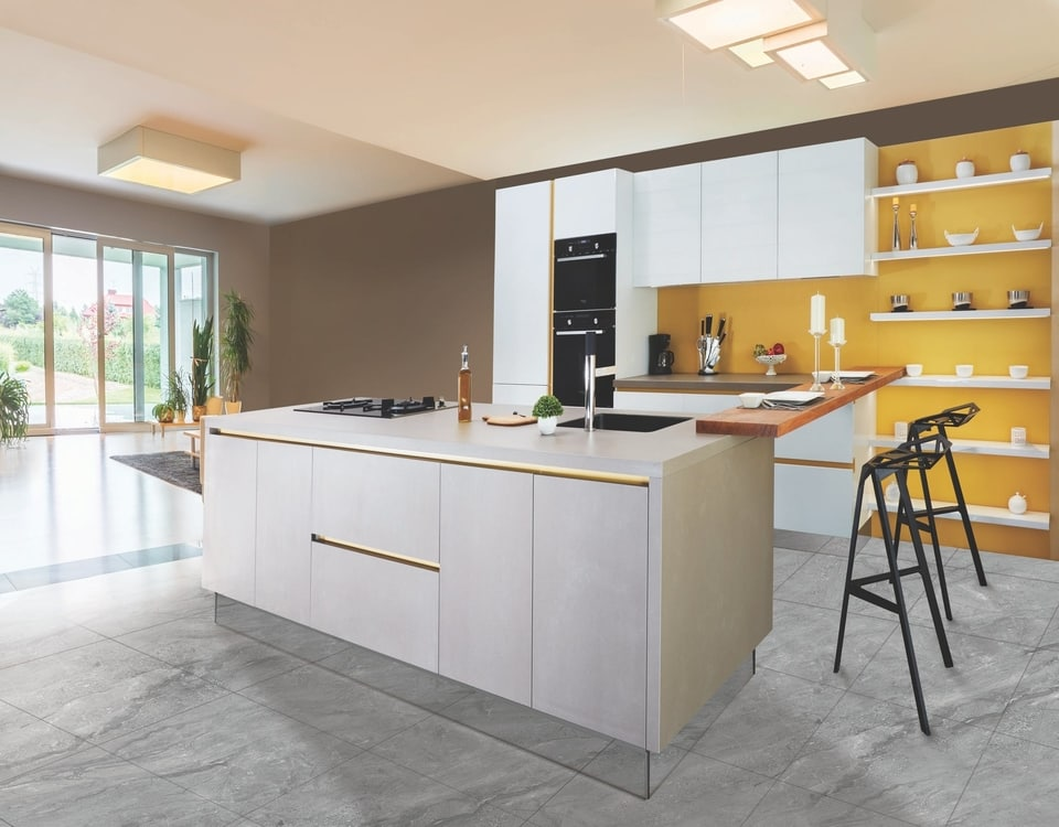 A new kitchen renovation in Alexandria with bright orange walls and a big cream breakfast bar
