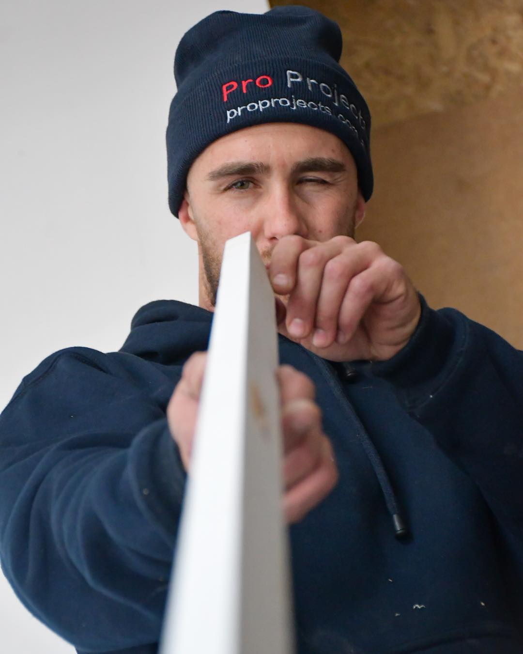 A worker of Pro Projects adding looking down kitchen renovation tool in Newtown