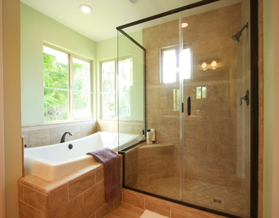 A Bronte Junction bathroom renovation with a big double shower and marble orange floor tiles